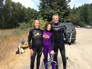 Martha and Sheida suit up to swim the Duwamish River with Washington Environmental Council's Mark Powell