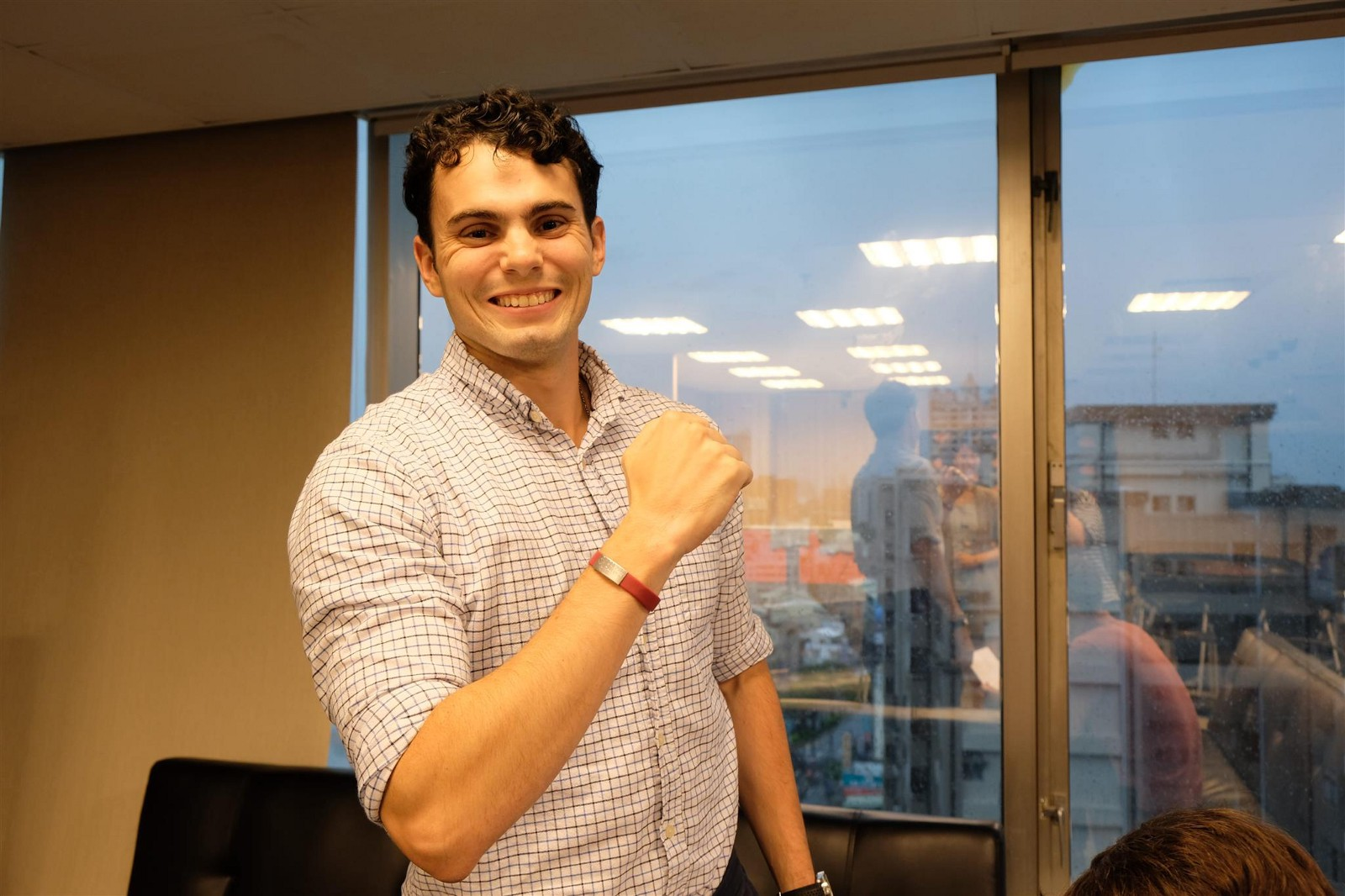 """Joey is showing off his new medical alert bracelet, which says """"食物過敏,"""" or """"Food Allergy"""" in Mandarin."""