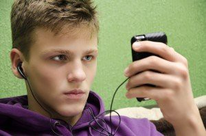 Angry lonely teen listening to music and expecting a call