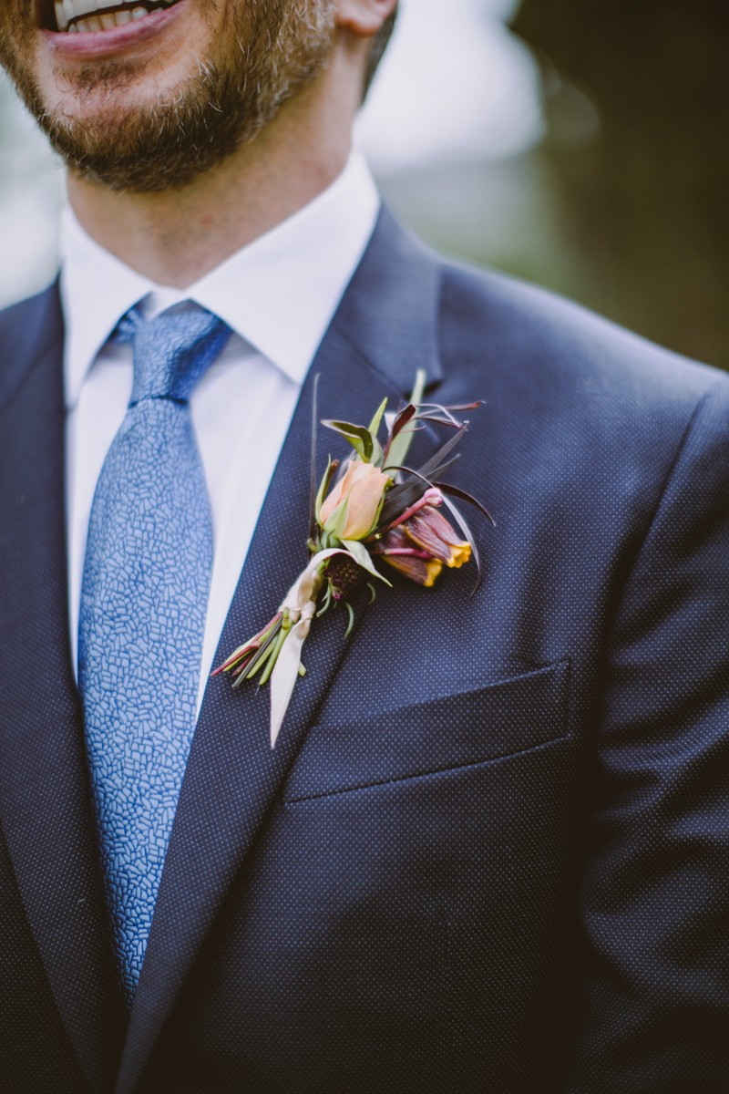 wildflower boutonniere - http://ruffledblog.com/modern-country-meets-secret-garden-wedding