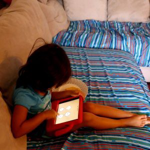 ooka island, kids reading on ipad