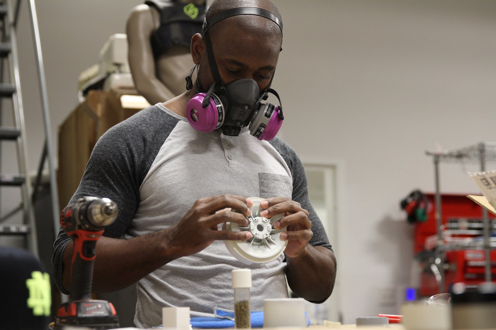 Industrial Designer, Raeshon McNeil working on the sensor unit prototype.