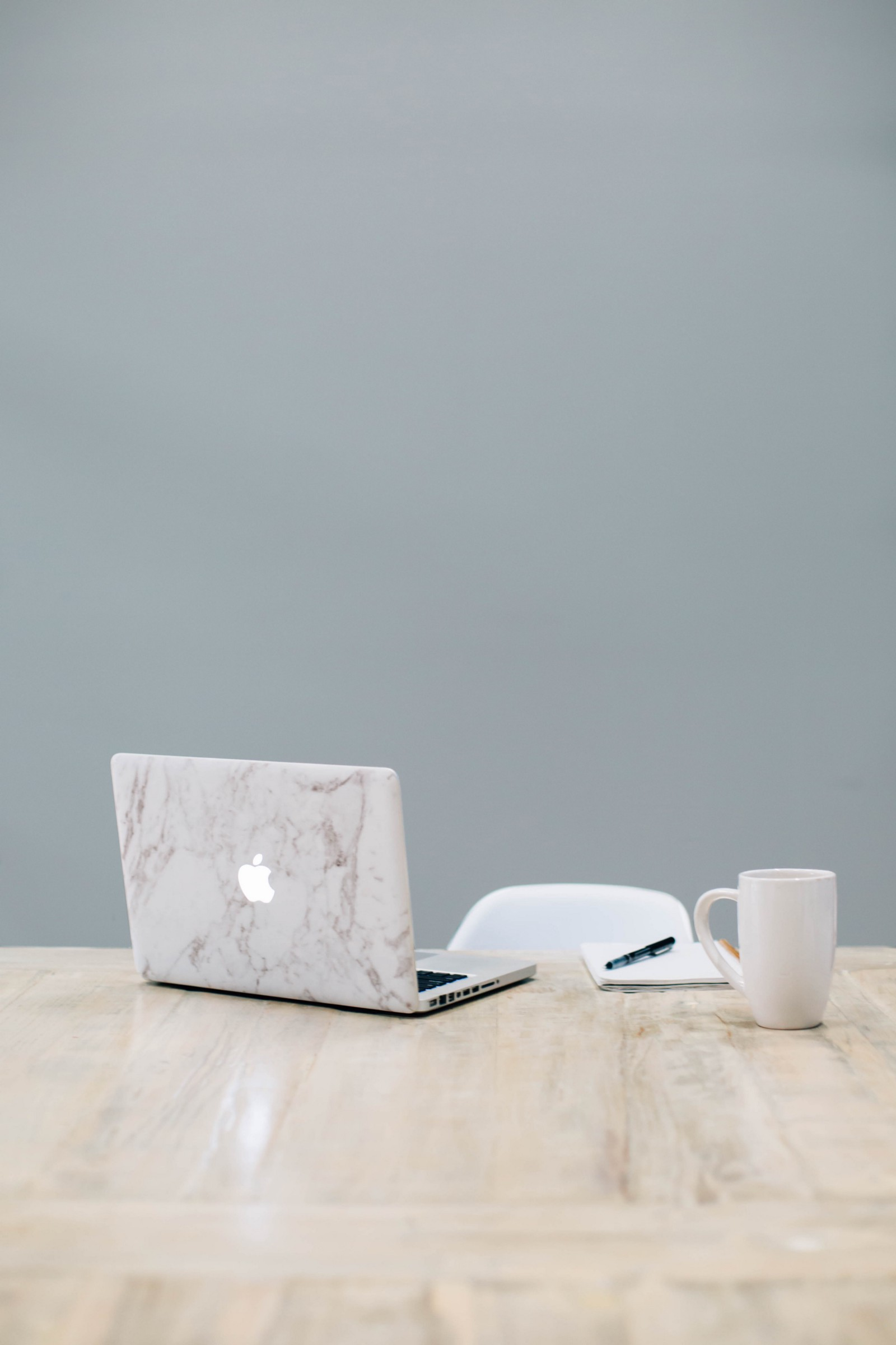 Macbook On Table Near Mug By Rachel Moenning Unsplash