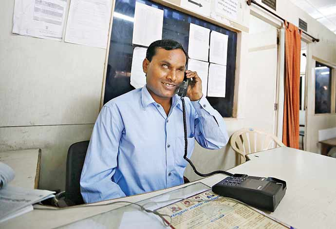 Kalbande attending a Phone Call a part of his daily routine work