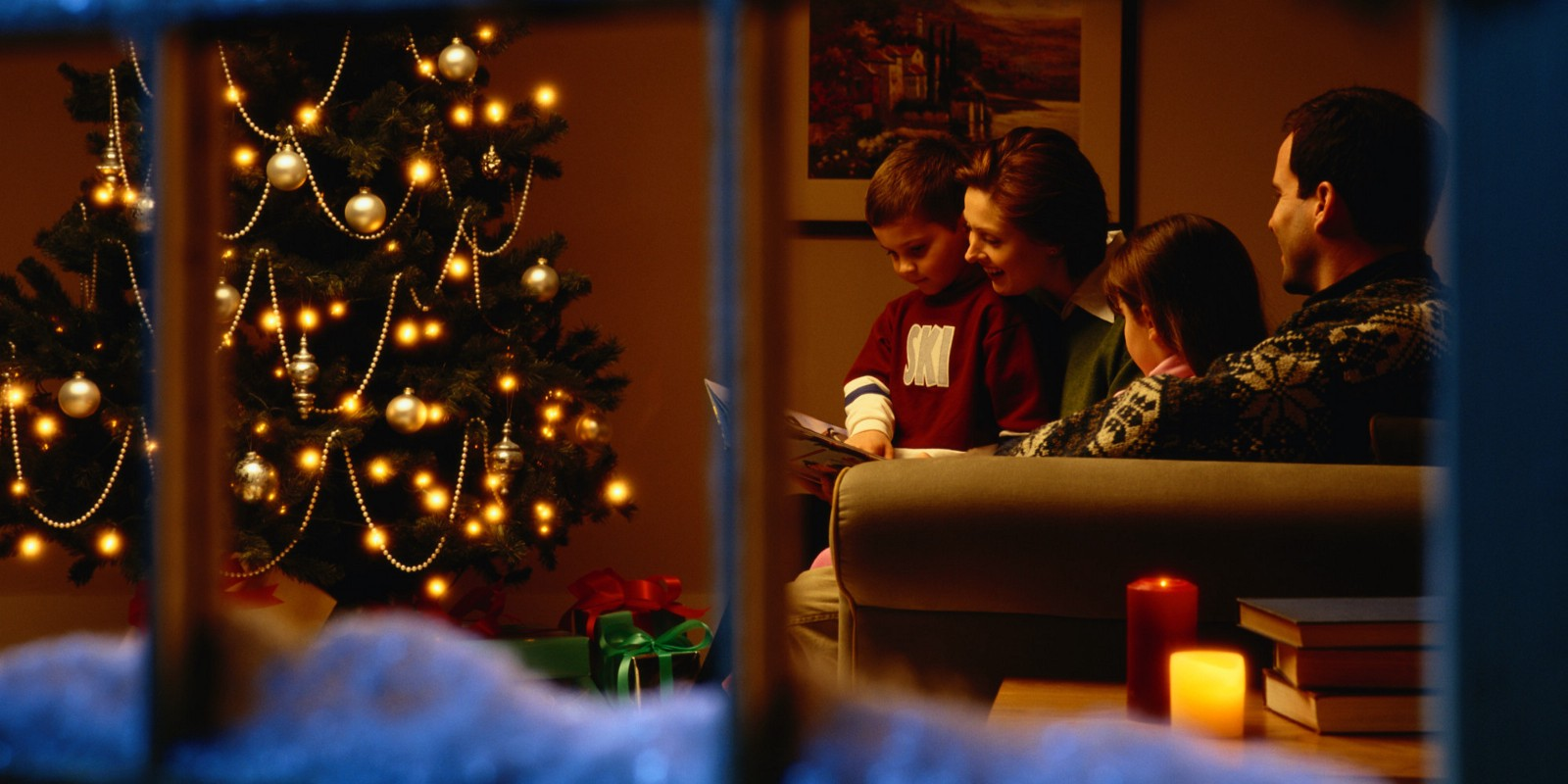 View Through a Window of a Family on Christmas Eve