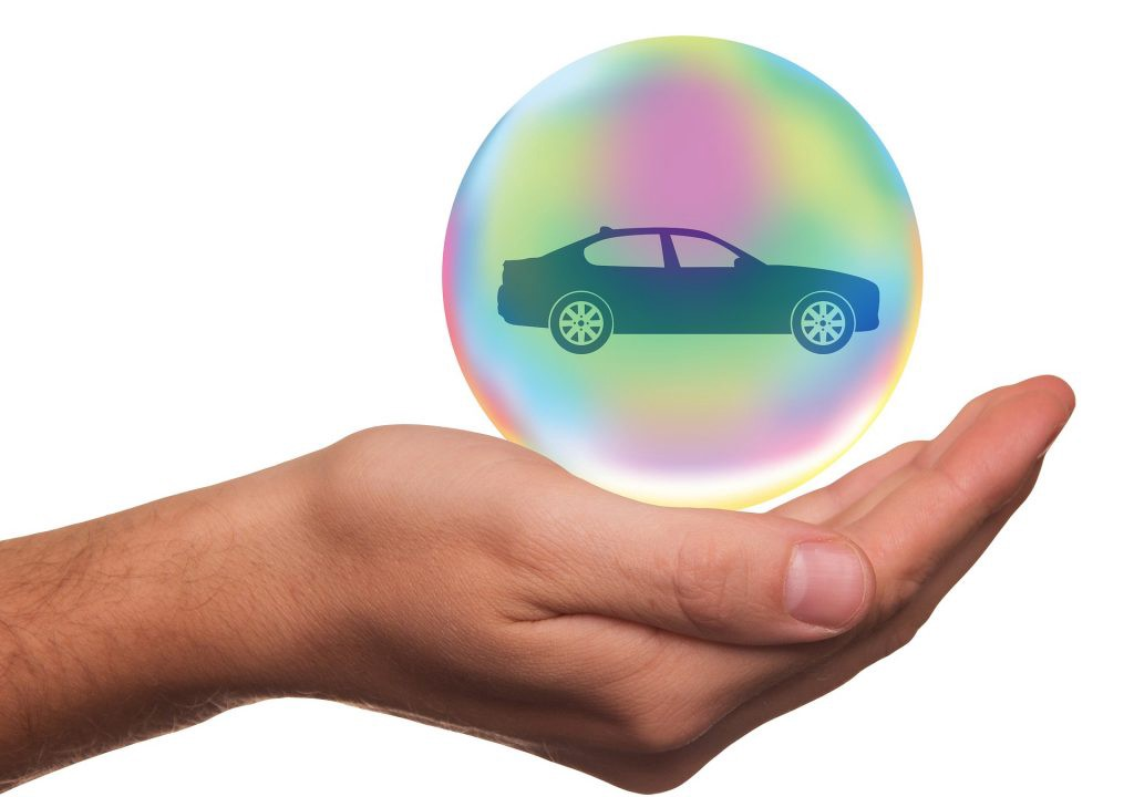 car in globe in the palm of your hand