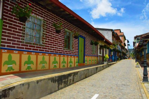 Colourful houses on a street in Guatape