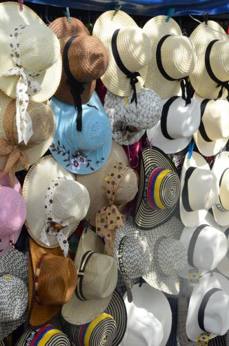 many different hats displayed guatape