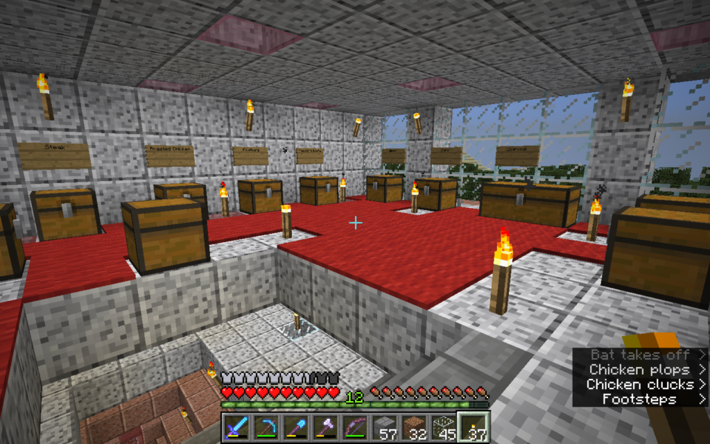 A room with about a dozen single-block boxes containing food and supplies, one type per box