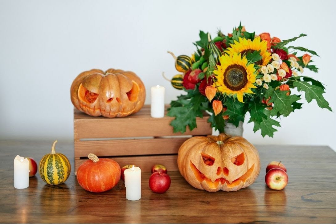 Pumpkin display for fall team building party—Book with Eva and Spark by Designs