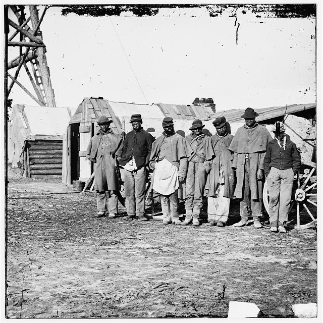 African Americans, freed from plantation slave holders, worked as teamsters at Bermuda Hundred to help the U.S. forces that freed them from the rebels of the civil war.   Credit: Hirst D. Milhollen and Donald H. Mugridge