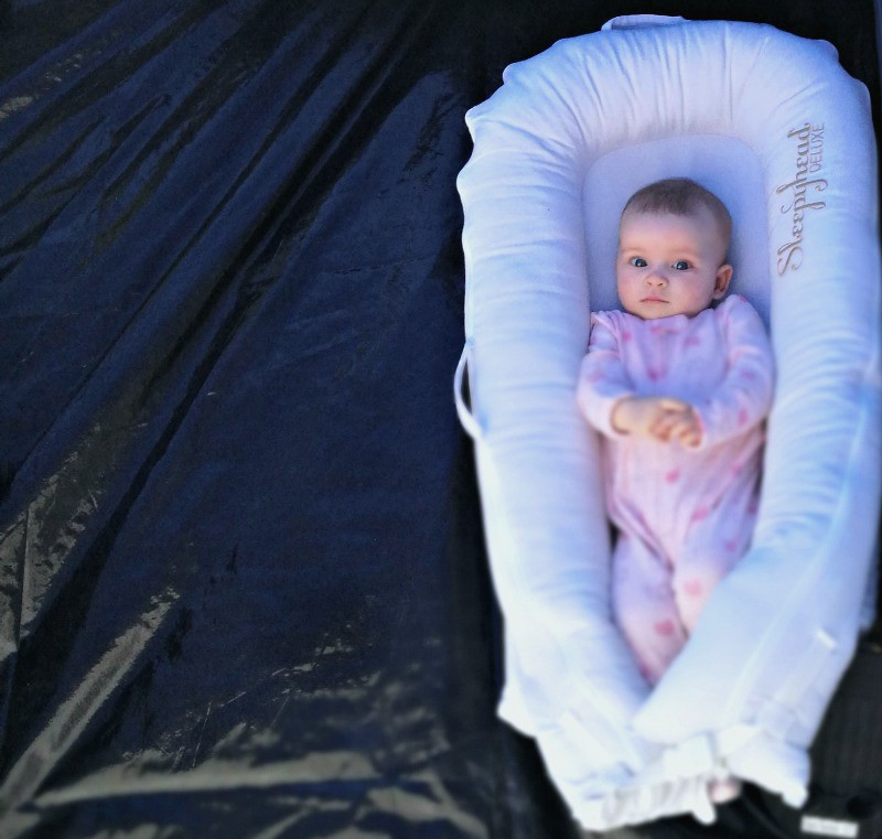 festival with a baby packing list - baby in sleephead pod in tent
