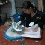 Sophie creating a potty prototype out of fiberglass