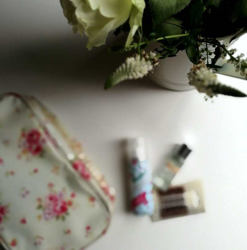 festival packing list baby - makeup flatlay white flowers