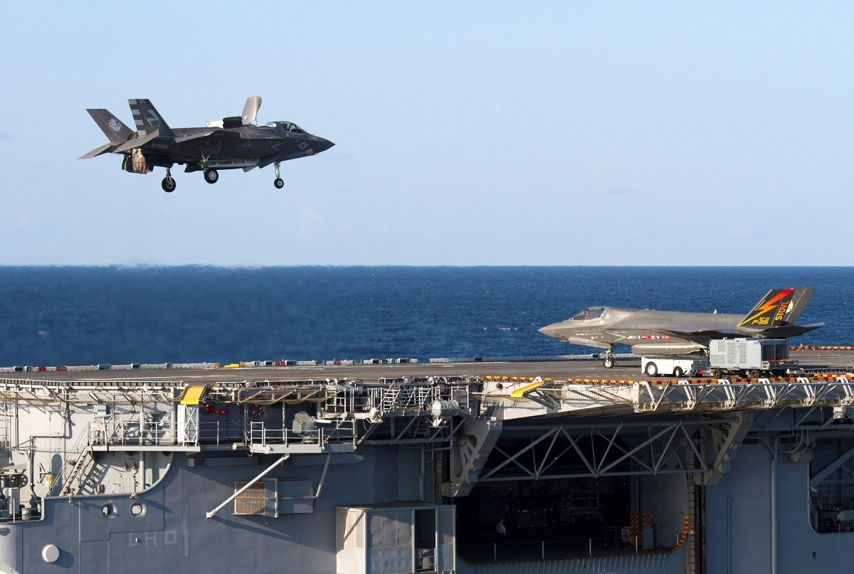 An F-35B Lightning II aircraft performs a vertical landing aboard the amphibious assault ship USS Wasp (LHD 1). Wasp is underway in support of F-35B Lightning II Developmental Testing phase II (DT-II). DT-II is a collaborative effort among the Navy, Marine Corps, and coalition partners to validate operational capabilities of the F-35B for amphibious platforms (LHD, LHA). (U.S. Navy photo by Lt. Michael J. Fallon/Released)