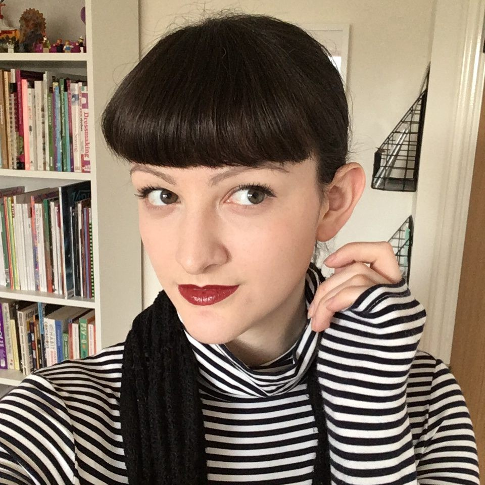 betty bangs vintage fringe with red lips and striped top