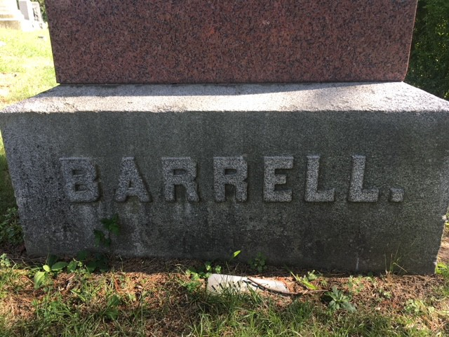gravestone featuring a period at the end of the family's name