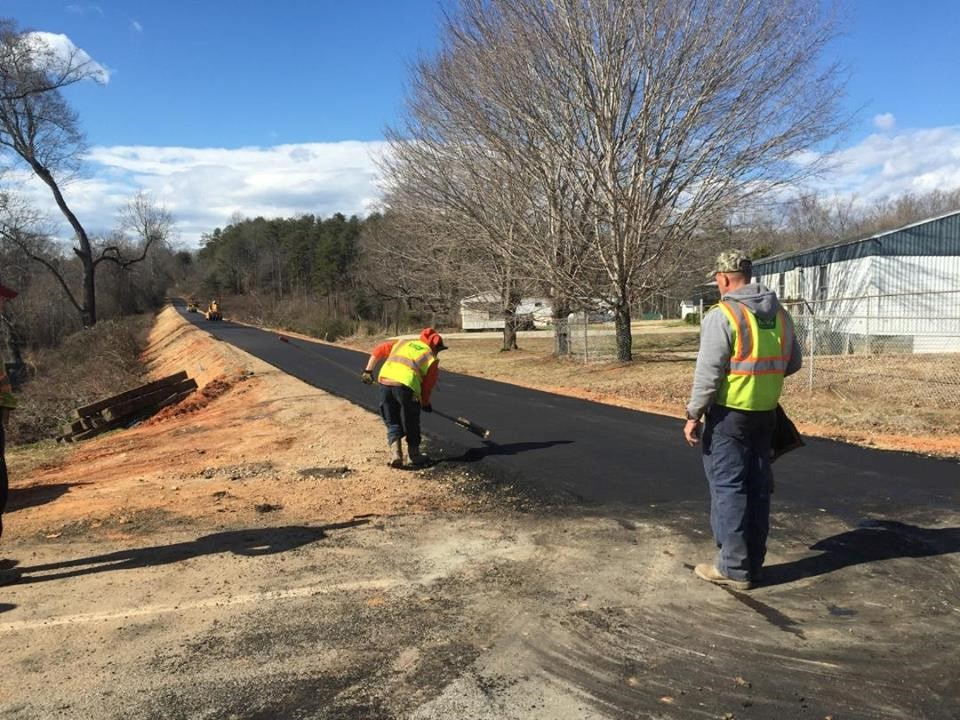 Asphalt surface course applied to the newly-compacted base.