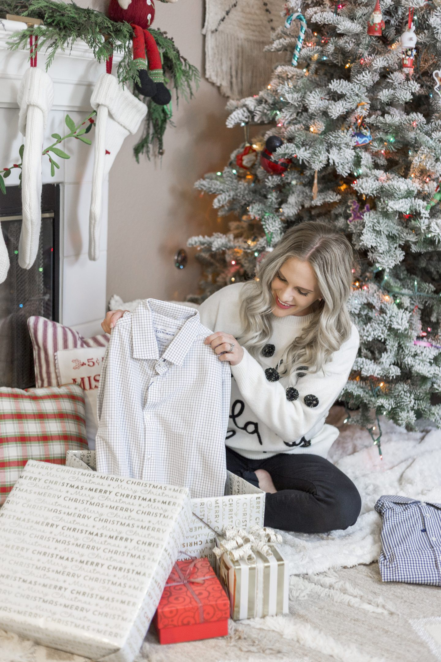 Mizzen+Main Shirts, the Perfect Gift for Him featured by top Orange County style blog, Dress Me Blonde: image of a woman opening a Christmas gift with a Mizzen+Main shirt