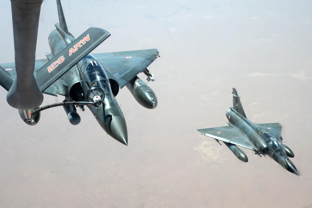 Above - A U.S. Air Force KC-135 tanker refuels French Mirage 2000 fighters. Air Force photo. At top - Russian Su-25 Frogfoot ground attackers take off from a base in Syria. Russian Ministry of Defense photo