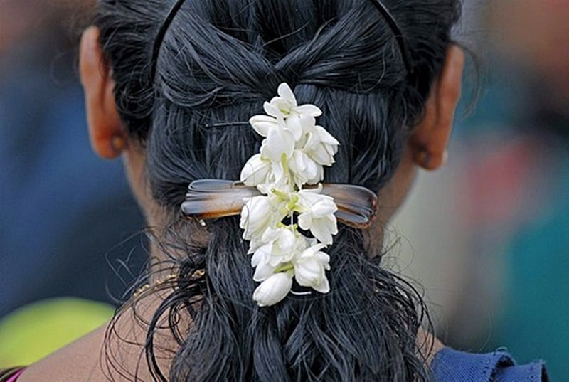 Jasmine flowers adds a natural beauty to the hair of a ladies in Kerala