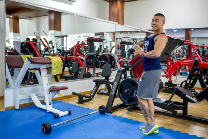 Kendy practices a pose at The Hinh Nam Nu Gym in District 7, Ho Chi Minh City, Vietnam.