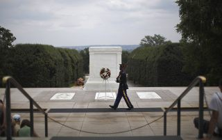 A Sentinel of the U.S. Army Old Guard marches past the Tomb of the Unknown Soldier at Arlington National Cemetery June 25, 2011. On this day, Paula Davis, mother of fallen U.S. Army Private Justin Ray Davis, 19, paid a tribute to him on the fifth anniversary of his death in Afghanistan. Paula Davis lost Justin while he fought in Afghanistan in 2006. He had vowed to his mom he'd never forget his childhood memories of September 11 and enlisted in the U.S. Army one week after graduating from high school. Picture taken June 25, 2011. REUTERS/Jason Reed   (UNITED STATES - Tags: MILITARY CONFLICT) - RTR2QN1C