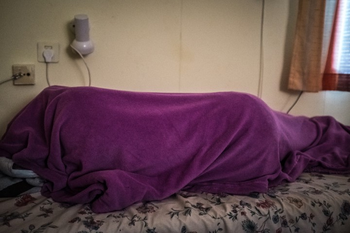 South Sudanese asylum seeker and athlete Esteer takes a nap before her training in her usual way: always completely and thoroughly covered.