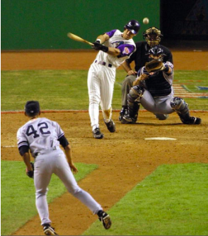 PHOENIX, UNITED STATES: Arizona Diamondbacks left fielder Luis Gonzalez hits his RBI single in the bottom of the 9th inning off New York Yankes relief pitcher Mariano Rivera (#42) which won Game 7 of the World Series for the Diamonbacks in Phoenix 04 November, 2001. The Diamondbacks defeated the New York Yankees 3-2, winning the series four games to three and become the 2001 world champions. AFP PHOTO Mike NELSON (Photo credit should read MIKE NELSON/AFP/Getty Images)