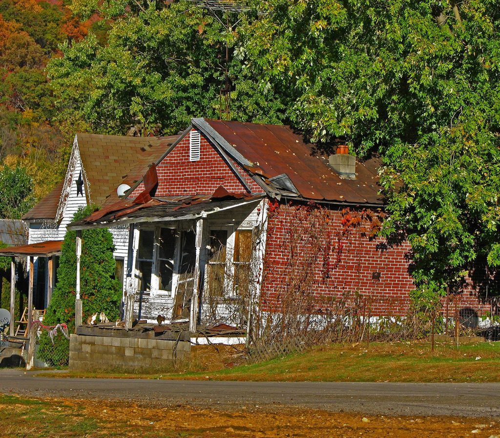 """Photo by Don O'Brien — a collapsing house """"[s]een during a visit to a small town along the Ohio Rver."""""""