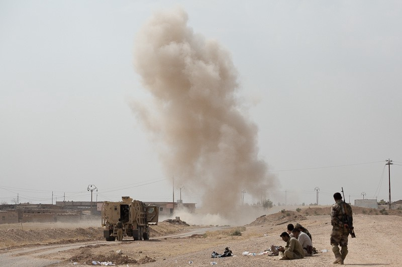 30/09/2015. Kirkuk, Iraq. Peshmerga engineers detonate an Islamic State laid improvised explosive device on a main road leading to the village of Mansuriya, west of Kirkuk, Iraq. Supported by coalition airstrikes around 3500 peshmerga of the Patriotic Union of Kurdistan (PUK) and the Kurdistan Democratic Party (KDP) engaged in a large offensive to push Islamic State militants out of villages to the west of Kirkuk. During previous offensives ISIS fighters withdrew after sustained coalition air support, but this time in many places militants stayed and fought. The day would see the coalition conduct around 50 airstrikes helping the joint peshmerga force to advance to within a few kilometres of the ISIS stronghold of Hawija and re-take around 17 villages. Around 20 peshmerga lost their lives to improvised explosive devices left by the Islamic State, reports suggest that between 40 and 150 militants were killed.