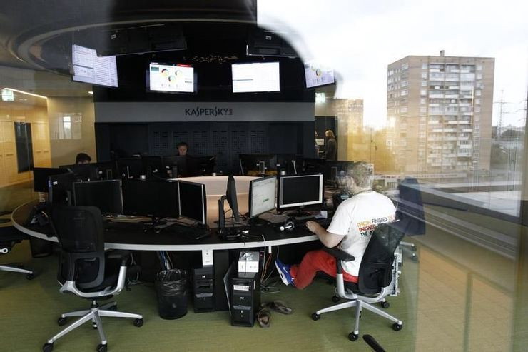 716708 an employee works near screens in the virus lab at the headquarters of russian cyber security compan