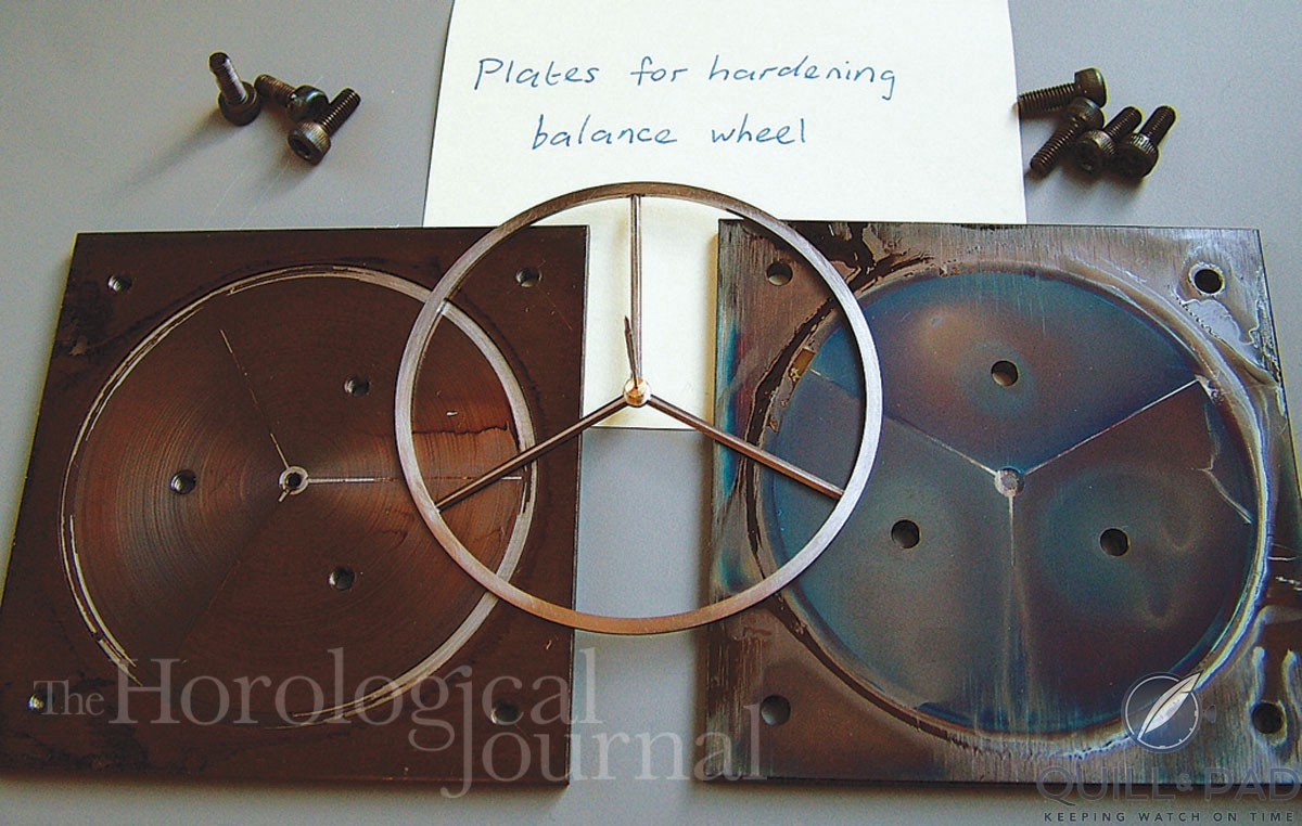Balance wheel hardening plates for Derek Pratt's H4 showing the balance at a later stage with the staff and collet in place.