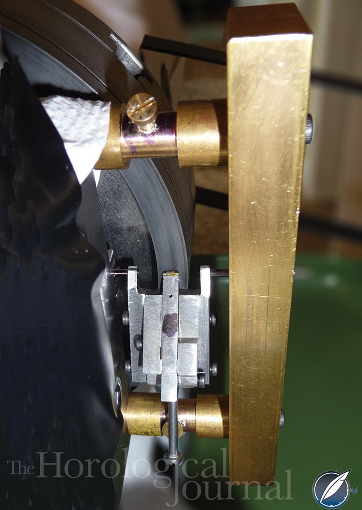 Pivoted pallet holder and lap mounted on the lathe to make the diamond pallets for Derek Pratt's H4 reconstruction (photo courtesy British Horological Journal)