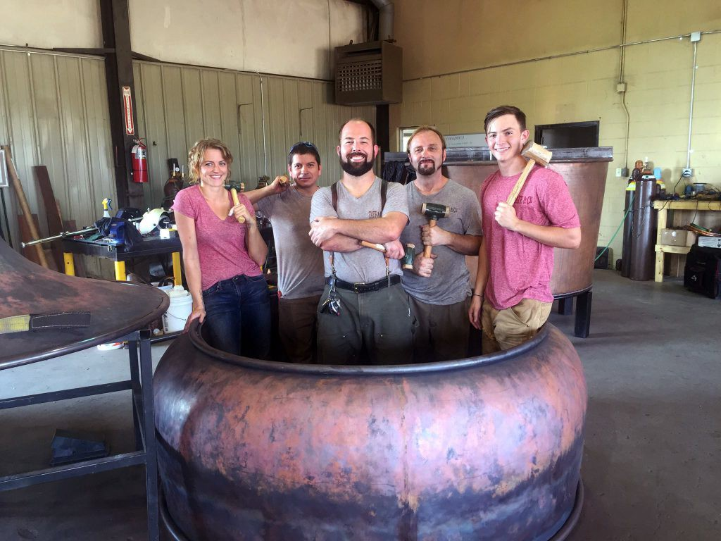 Tate & Co. founder Chip Tate (C) and his team. Image courtesy Tate & Co. via Facebook.