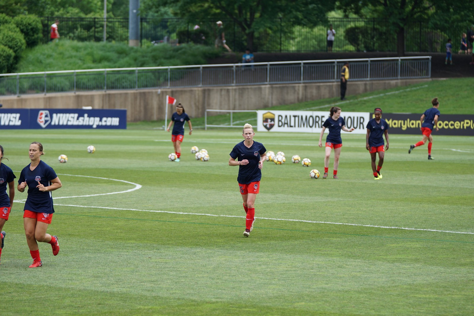 female soccer players warming up