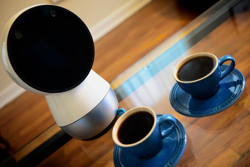 Jibo and coffee cups on the glass table