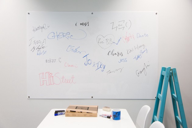 Signed acrylic whiteboard at startup HiStreet Hong Kong office