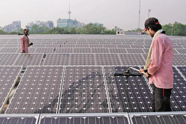 Solar modules, essentially photovoltaic cells connected in a series, are a key component for solar plants and account for almost 60% of the project cost. Photo: Bloomberg