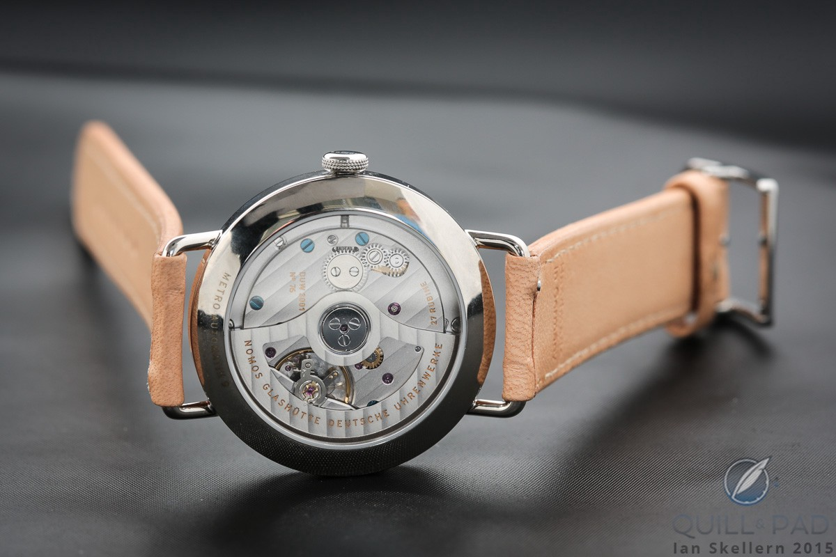 A look at the very aesthetic Caliber 3001 through the transparent case back of the Nomos Glashütte Neomatik Metro