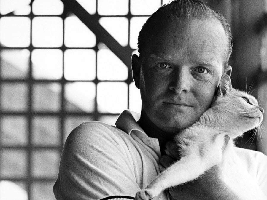 Truman Capote holding a cat