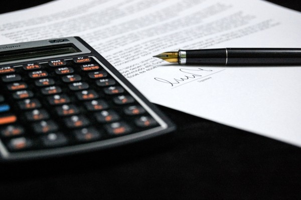 legal-contract-and-calculator-on-table