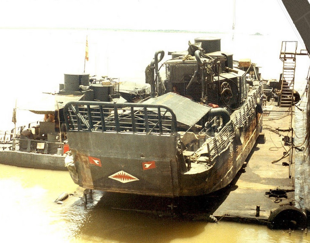 """Above - one of the two """"douche boats."""" Ray Longaker Jr. photo via WarBoats.org. At top - a regular armored transport. Navy photo"""