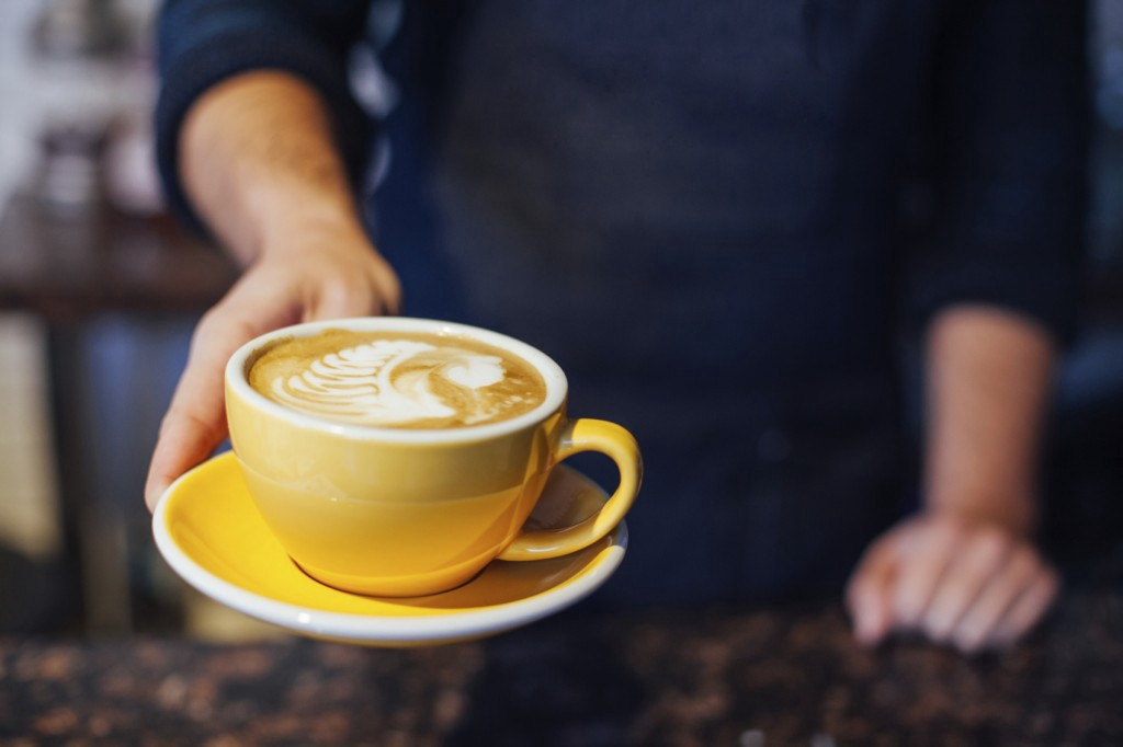 offering a cup of coffee