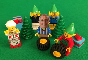 Here is Scott helping Mrs. Claus and the elves make improvements to Santa's wagon