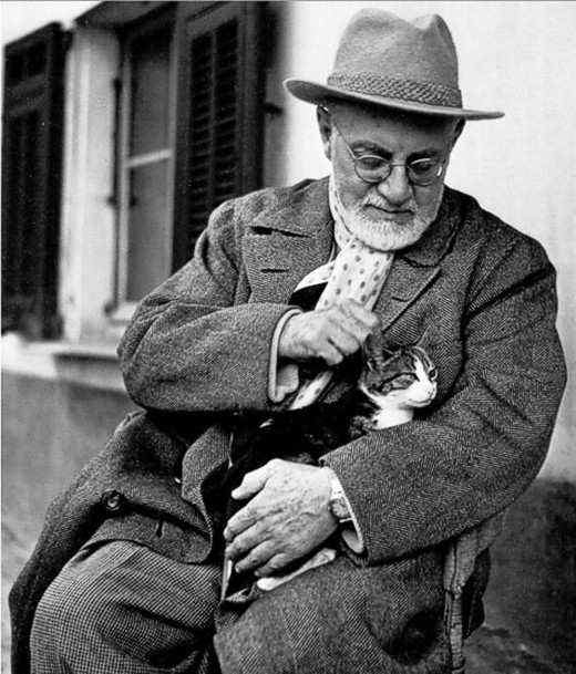Matisse enjoying an afternoon break from painting with his cat, Minouche, at his apartment and studio in Nice
