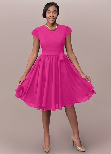 08b73fcee5 Ingrid is our chiffon dress in an A-line cut. This knee-length dress  includes a sewn-in bow in the side with a layered hem and short sleeves for  a more ...