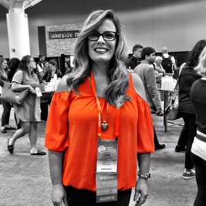 Lisa Dougherty in a tangerine cold-shoulder top