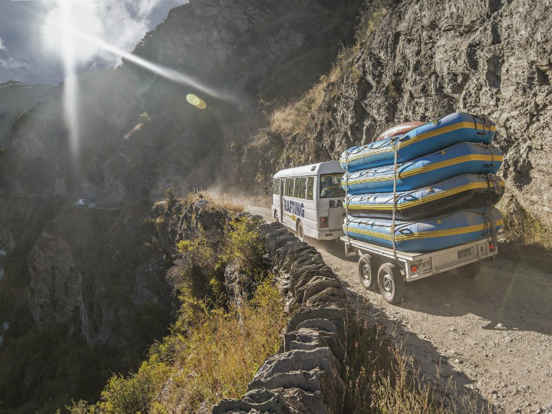 Queenstown-Rafting-Shotover-River-Buses-heading-in-on-the-Skippers-Canyon-Road-as-the-first-trip-departs-small