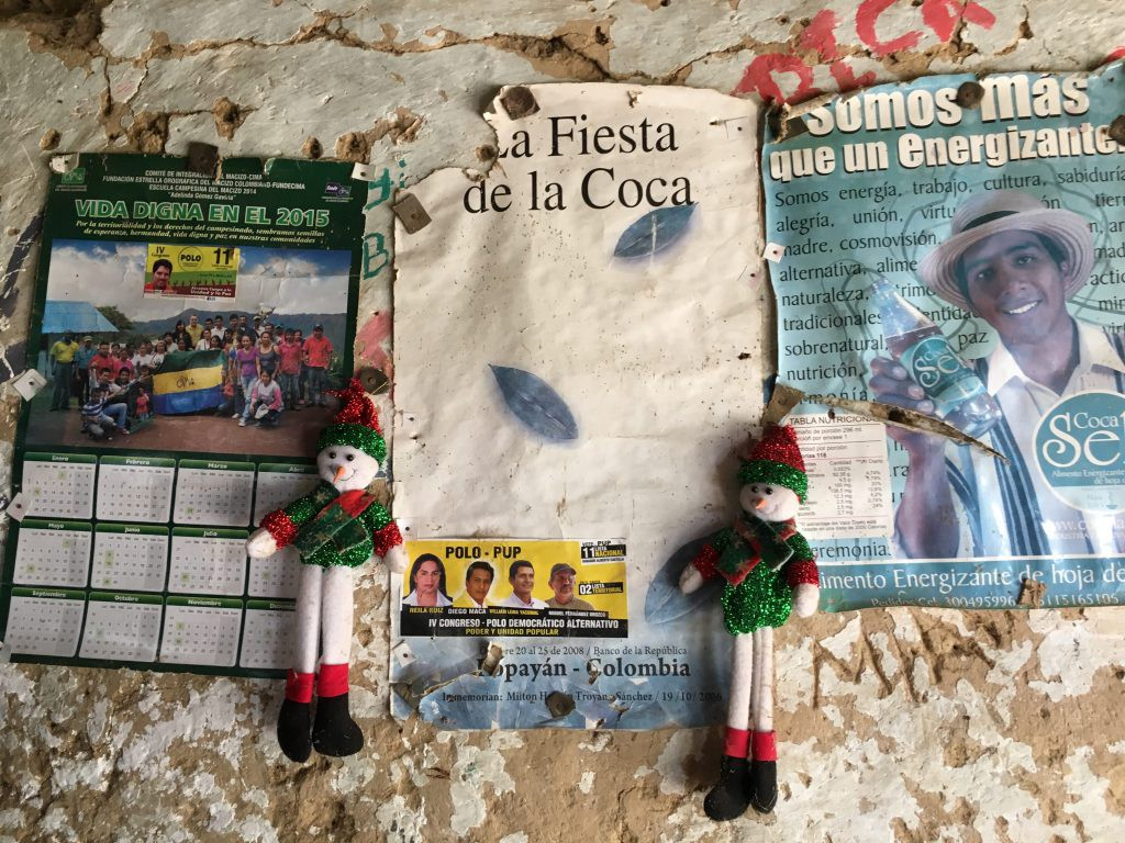 Posters advertising the festival of coca, and a coca-laced beverage in a home outside Lerma